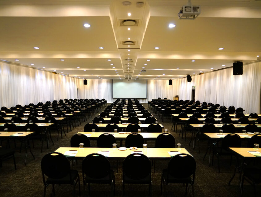 birchwood's le grande centre acacia chamber, rows of tables and chairs in front of projector screen