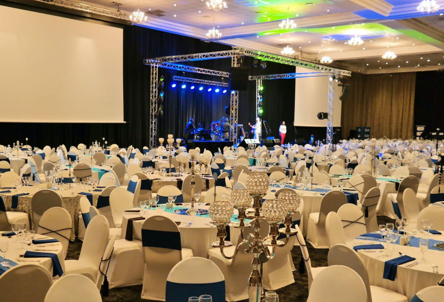 birchwood OR tambo centre with projector screen and set dining tables