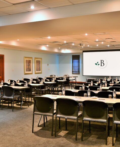 birchwood's petit center albena room, tables and chairs set up in front of projector screen
